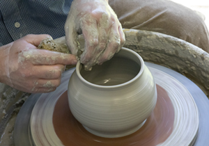 Mike Chatterley making a pot at Pottery Wheel